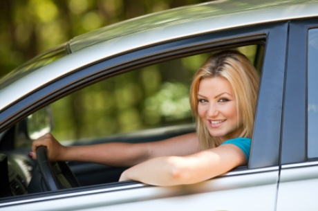 An image of a girl driving with auto  insurance | Insurance Canton Oh